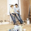 Couple taking a break from painting — Stock Photo #33831285