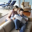 Couple reading newspaper — Stock Photo
