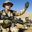Soldier with weapon signaling — Stock Photo #33831839