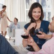Couples drinking wine in living room — Stock Photo #33832243
