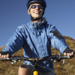 Womon bicycle in field — Stock Photo #33832381