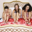 Teenage Girls in pyjamas painting toenails — Stock Photo #33832617