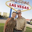 Couple in front of welcome to Las Vegas sign — Stock Photo #33832767