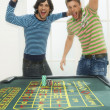 Men celebrating on roulette table — Stock Photo #33832777