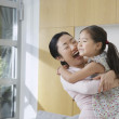 Smiling Woman Hugging her Daughter — Stock Photo