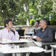 Stock Photo: Two men talking at cafe