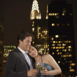 Couple toasting champagne against New York — Stock Photo