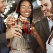 Friends toasting standing at bar — Stock Photo