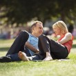 Stok fotoğraf: Couple reclining in park