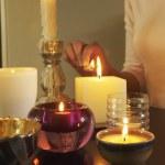 Woman Lighting Candles — Stock Photo #33833515