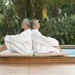 Couple Relaxing by Poolside — Stock Photo