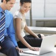 Business couple with laptop — Stock Photo #33835843