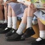 Schoolkids sitting — Stock Photo