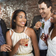 Two couples holding drinks standing in bar — Stock Photo #33836005
