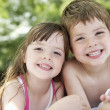 Boy and girl in backyard — Stock Photo