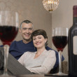 Smiling couple in living room — Stock Photo #33836195