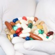 Various medication in hands — Stock Photo