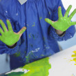 Stock Photo: Boy finger painting