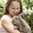 Stock Photo: Girl holding bunny rabbit