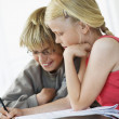 Brother and Sister Doing Homework — Stock Photo #33838297