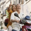 Stock Photo: Couple sightseeing on scooter