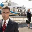 Businesspeople by helicopter — Stock Photo