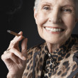 Stock Photo: Senior WomSmoking Cigarillo