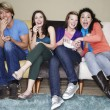 Friends eating popcorn watching movie — Stock Photo