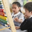 Elementary students using abacus — Stock Photo