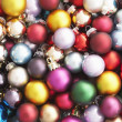 Pile of Christmas baubles — Stockfoto