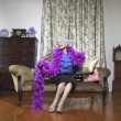 Stock Photo: Senior womwearing feather boa
