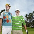 Male golfers standing  on green — Stock Photo #33839447