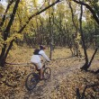 Stock Photo: Biker riding on forest trail