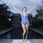 Senior woman posing by pool — Stock Photo #33839991