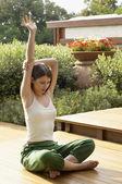Woman practising yoga — Stock Photo