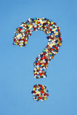 Pills forming question mark — Stock Photo