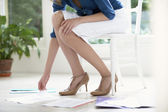 Woman Sorting Papers on floor — Stock Photo