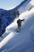 Snowboarder on mountain slope — Foto Stock