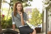 Woman Thinking while sitting — Stock Photo