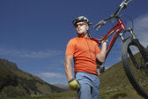 Cyclist carrying bike — Stock Photo