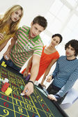 Friends Gambling on roulette table — Stock Photo
