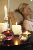 Woman Relaxing with Candles — Stock Photo