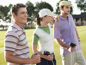 Young golfers on court — Stock Photo