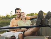 Couple sitting in jeep — Stock Photo