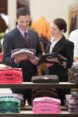 Salesperson assisting businessman — Stock Photo