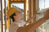 Construction worker working on building window — Stock Photo