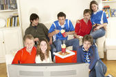 Friends watching sport on TV — Stock Photo