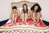 Teenage Girls in pyjamas painting toenails — Stok fotoğraf