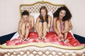 Teenage Girls in pyjamas painting toenails — Foto de Stock