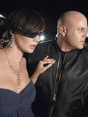 Woman in sunglasses with bodyguard — Stock Photo